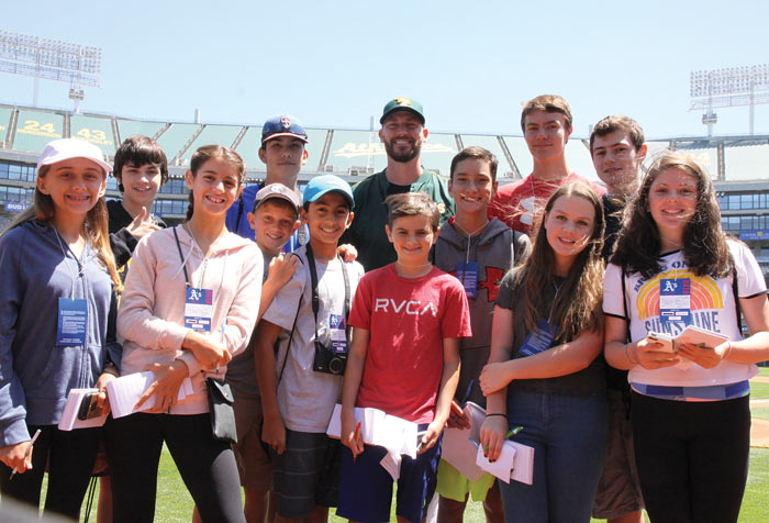 Image of FastForward reporters on location with the Oakland A's